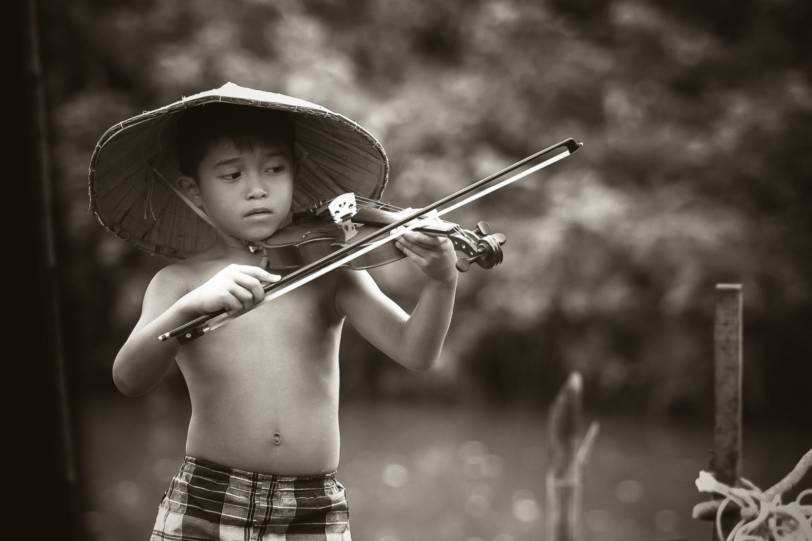 boy playing violin without fear